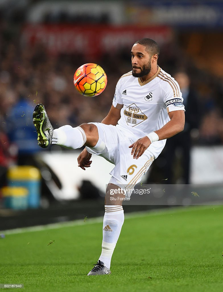 Swansea player <a gi-track='captionPersonalityLinkClicked' href=/galleries/search?phrase=Ashley+Williams+-+Soccer+Player&family=editorial&specificpeople=13495389 ng-click='$event.stopPropagation()'>Ashley Williams</a> in action during the Barclays Premier League match between Swansea City and West Ham United at the Liberty Stadium on December 20, 2015 in Swansea, Wales.