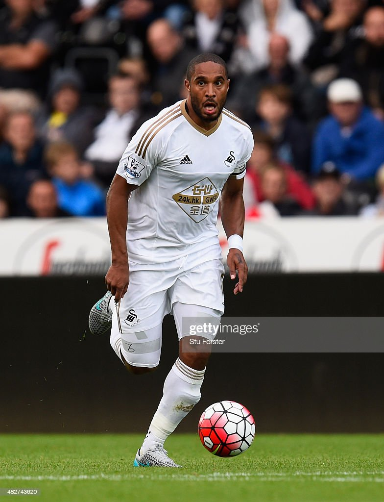 Swansea player <a gi-track='captionPersonalityLinkClicked' href=/galleries/search?phrase=Ashley+Williams+-+Soccer+Player&family=editorial&specificpeople=13495389 ng-click='$event.stopPropagation()'>Ashley Williams</a> in action during the Pre season friendly match between Swansea City and Deportivo La Coruna at Liberty Stadium on August 1, 2015 in Swansea, Wales.