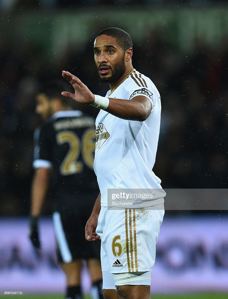Swansea player <a gi-track='captionPersonalityLinkClicked' href=/galleries/search?phrase=Ashley+Williams+-+Soccer+Player&family=editorial&specificpeople=13495389 ng-click='$event.stopPropagation()'>Ashley Williams</a> reacts during the Barclays Premier League match between Swansea City and Leicester City at Liberty Stadium on December 5, 2015 in Swansea, Wales.