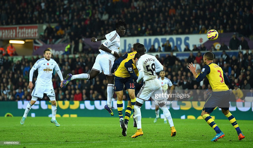 Swansea player <a gi-track='captionPersonalityLinkClicked' href=/galleries/search?phrase=Bafetimbi+Gomis&family=editorial&specificpeople=686005 ng-click='$event.stopPropagation()'>Bafetimbi Gomis</a> (c) heads the second Swansea goal during the Barclays Premier League match between Swansea City and Arsenal at Liberty Stadium on November 9, 2014 in Swansea, Wales.