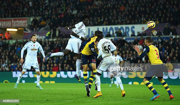 Swansea player Bafetimbi Gomis heads the second Swansea goal during the Barclays Premier League match between Swansea City and Arsenal at Liberty...