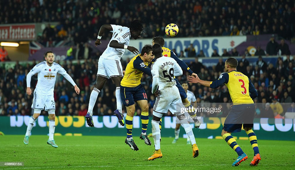 Swansea player Bafetimbi Gomis (c) heads the second Swansea goal during the Barclays Premier League match between Swansea City and Arsenal at Liberty Stadium on November 9, 2014 in Swansea, Wales.