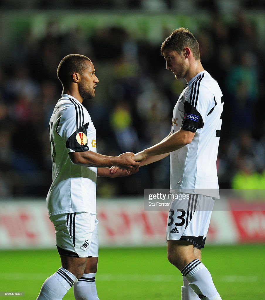 Swansea player Ben Davies (r) celebrates with goalscorer <a gi-track='captionPersonalityLinkClicked' href=/galleries/search?phrase=Wayne+Routledge&family=editorial&specificpeople=206672 ng-click='$event.stopPropagation()'>Wayne Routledge</a> after the first Swansea goal during the UEFA Europa League match between Swansea City and FC St Gallen at Liberty Stadium on October 3, 2013 in Swansea, Wales.