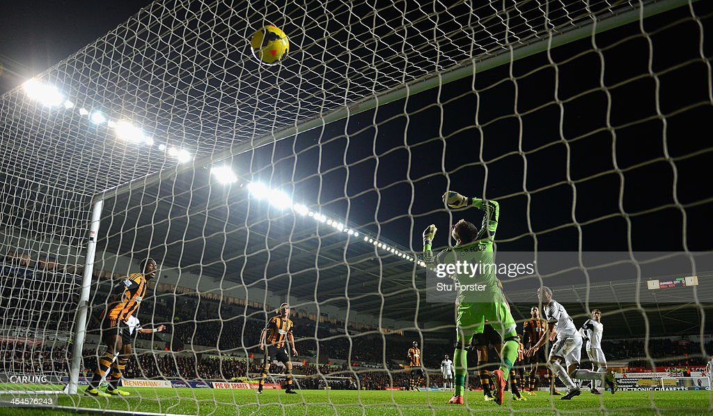 Swansea player Chico Flores scores the first Swansea goal past Hull goalkeeper Aallan McGregor during the Barclays Premier league match between...