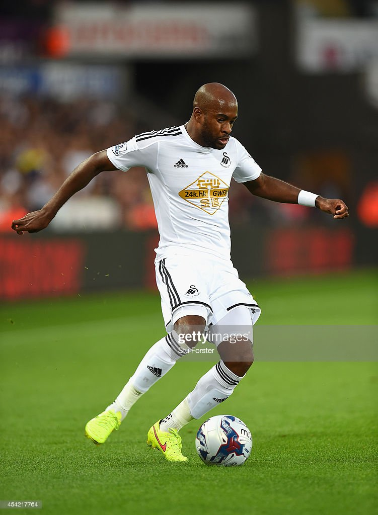 Swansea player <a gi-track='captionPersonalityLinkClicked' href=/galleries/search?phrase=Dwight+Tiendalli&family=editorial&specificpeople=600413 ng-click='$event.stopPropagation()'>Dwight Tiendalli</a> in action during the Capital One Cup Second Round match between Swansea City and Rotherham United at Liberty Stadium on August 26, 2014 in Swansea, Wales.