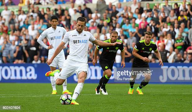 Swansea player Gylfi Sigurdsson scores from the penalty spot during the Premier League match between Swansea City and Chelsea at Liberty Stadium on...