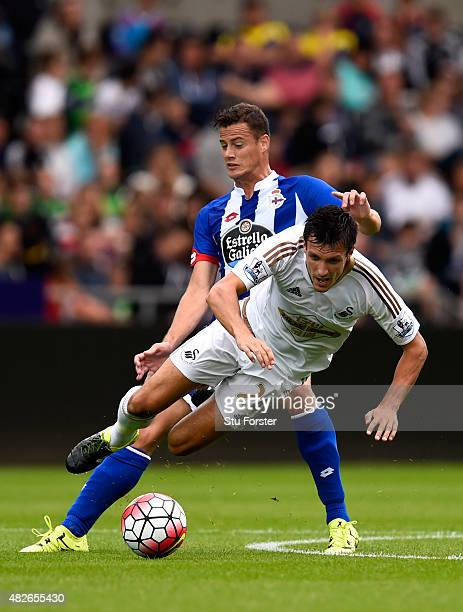 Swansea player Jack Cork is fouled by Oriol Riera of Deportiva during the Pre season friendly match between Swansea City and Deportivo La Coruna at...