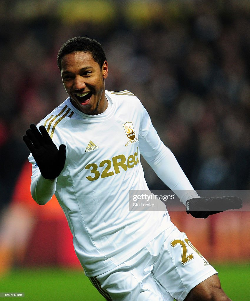 Swansea player <a gi-track='captionPersonalityLinkClicked' href=/galleries/search?phrase=Jonathan+de+Guzman&family=editorial&specificpeople=674543 ng-click='$event.stopPropagation()'>Jonathan de Guzman</a> celebrates after his free kick went in for the second Swansea goal during the Barclays Premier League match between Swansea City and Stoke City at Liberty Stadium on January 19, 2013 in Swansea, Wales.