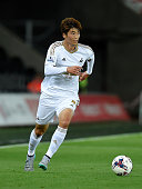 Swansea player Ki Sung Yueng in action during the Capital One Cup Second Round match between Swansea City and York City at Liberty Stadium on August...