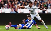 Swansea player Kyle Naughton challenges Luisinho of Deportiva during the Pre season friendly match between Swansea City and Deportivo La Coruna at...
