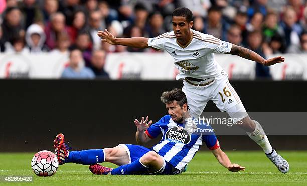 Swansea player Kyle Naughton challenges Luisinho of Deportiva during the Pre season friendly match between Swansea City and Deportivo La Coruna at...