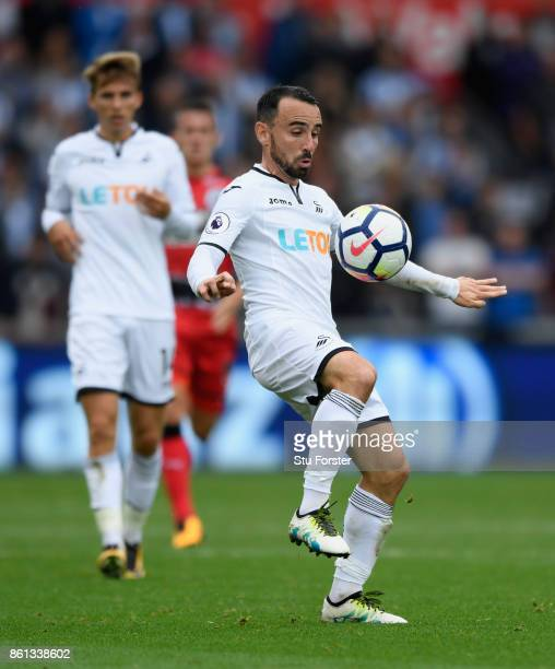 Swansea player Leon Britton in action during the Premier League match between Swansea City and Huddersfield Town at Liberty Stadium on October 14...