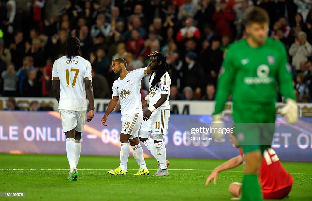 Swansea player Marvin Emnes (r) is congratulated after scoring the third goal during the Capital One Cup Second Round match between Swansea City and York City at Liberty Stadium on August 25, 2015 in Swansea, Wales.