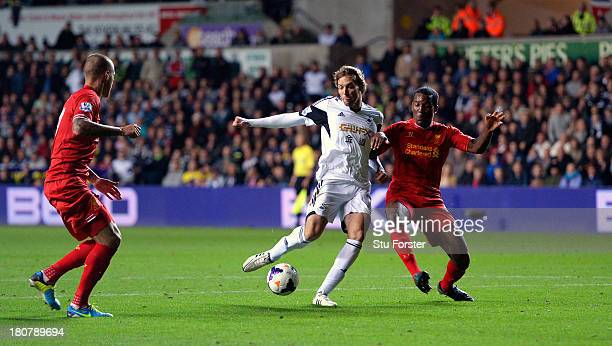 Swansea player Michu beats Andre Wisdom to the ball to score the second Swansea goal during the Barclays Premier League match between Swansea City...