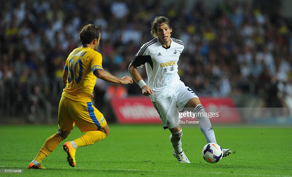 Swansea player Michu (r) beats Filipe Teixeira to set up the fifth Swansea goal during the UEFA Europa League play-off first leg between Swansea City and FC Petrolul Ploiesti at Liberty Stadium on August 22, 2013 in Swansea, Wales.