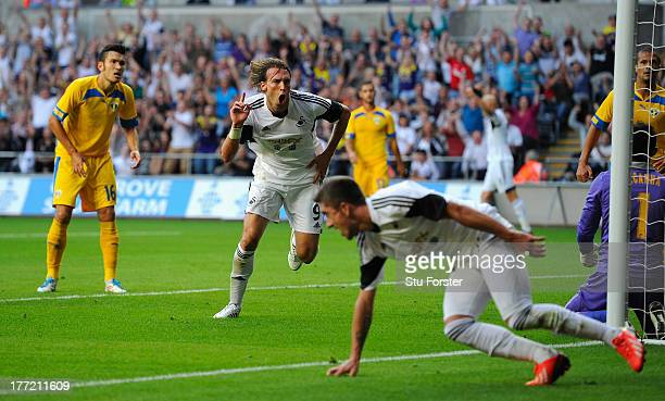 Swansea player Michu celebrates after scoring the second swansea goal during the UEFA Europa League playoff first leg between Swansea City and FC...