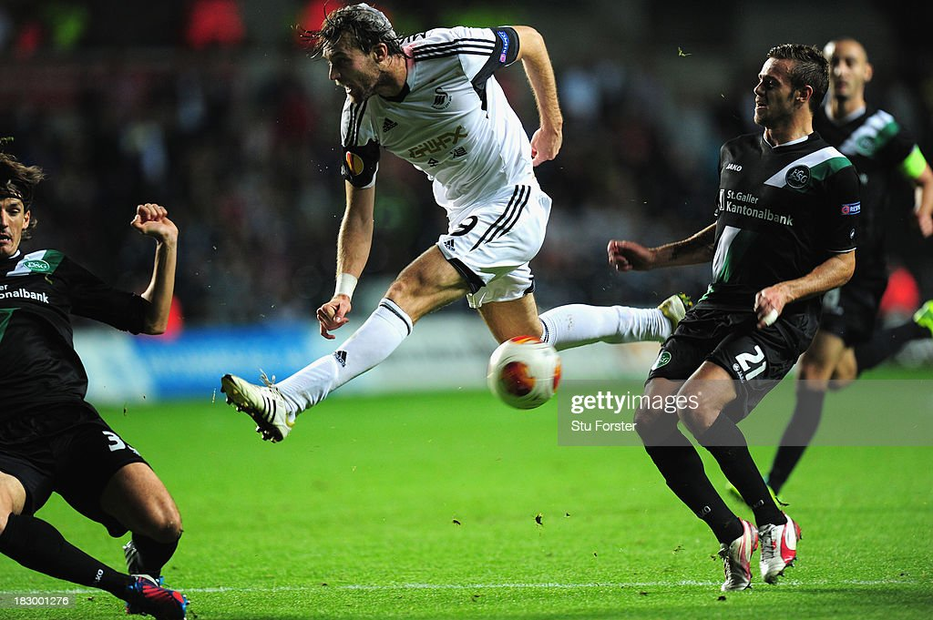 Swansea player Michu has a shot blocked during the UEFA Europa League match between Swansea City and FC St Gallen at Liberty Stadium on October 3, 2013 in Swansea, Wales.