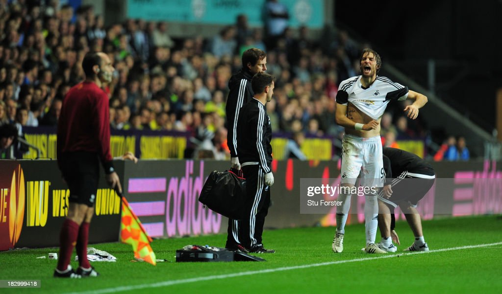 Swansea player Michu has words with the assistant referee during the UEFA Europa League match between Swansea City and FC St Gallen at Liberty Stadium on October 3, 2013 in Swansea, Wales.