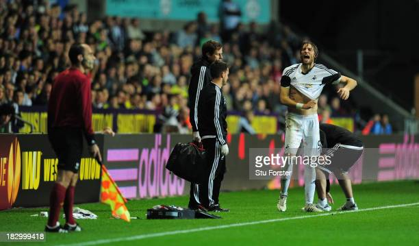 Swansea player Michu has words with the assistant referee during the UEFA Europa League match between Swansea City and FC St Gallen at Liberty...