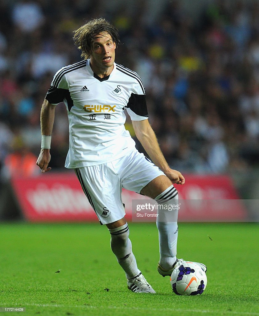 Swansea player Michu in action during the UEFA Europa League play-off first leg between Swansea City and FC Petrolul Ploiesti at Liberty Stadium on August 22, 2013 in Swansea, Wales.