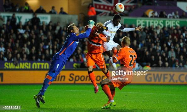 Swansea player Nathan Dyer is challenged by the Valencia goalkeeper Diego Alves during the UEFA Europa League group A match between Swansea City and...