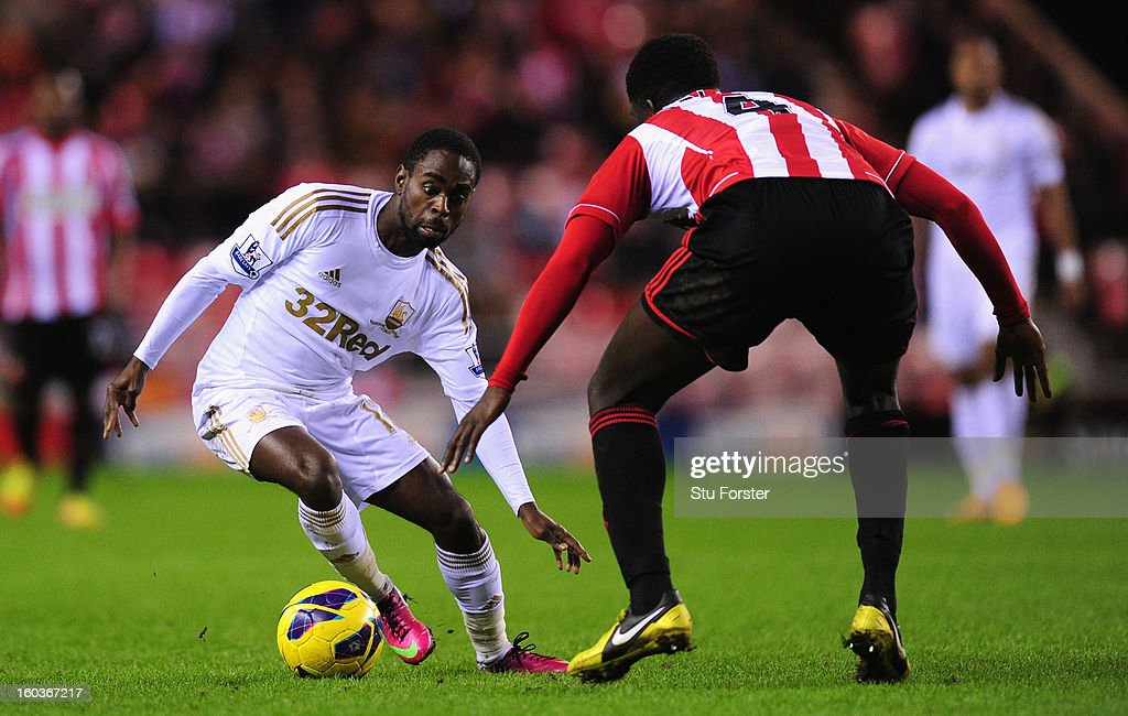 Swansea player Nathan Dyer runs at Sunderland player <a gi-track='captionPersonalityLinkClicked' href=/galleries/search?phrase=Alfred+N%27Diaye&family=editorial&specificpeople=5553791 ng-click='$event.stopPropagation()'>Alfred N'Diaye</a> during the Barclays Premier League match between Sunderland and Swansea City at Stadium of Light on January 29, 2013 in Sunderland, England.
