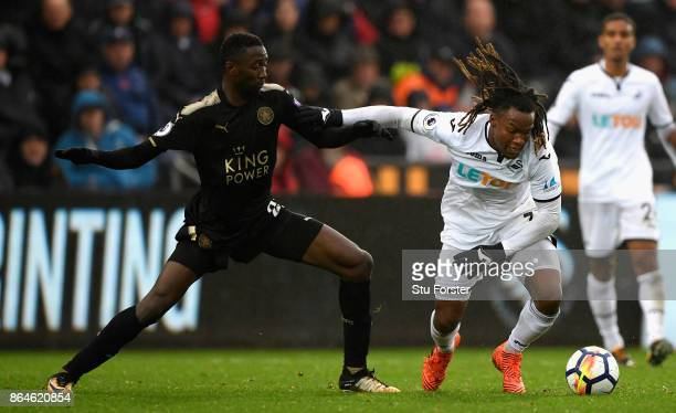 Swansea player Renato Sanches is challenged by Wilfred Ndidi of Leicester during the Premier League match between Swansea City and Leicester City at...