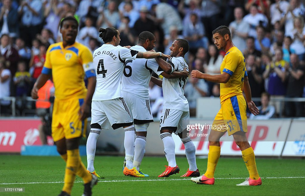Swansea player Wayne Routledge (r) celebrates with team mates after opening goal during the UEFA Europa League play-off first leg between Swansea City and FC Petrolul Ploiesti at Liberty Stadium on August 22, 2013 in Swansea, Wales.