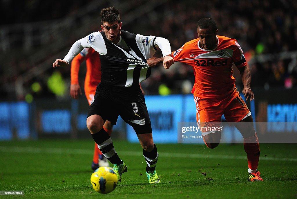 Swansea player Wayne Routledge is challenged by <a gi-track='captionPersonalityLinkClicked' href=/galleries/search?phrase=Davide+Santon&family=editorial&specificpeople=5679382 ng-click='$event.stopPropagation()'>Davide Santon</a> during the Barclays Premier league game between Newcastle United and Swansea City at St James' Park on December 17, 2011 in Newcastle upon Tyne, England.