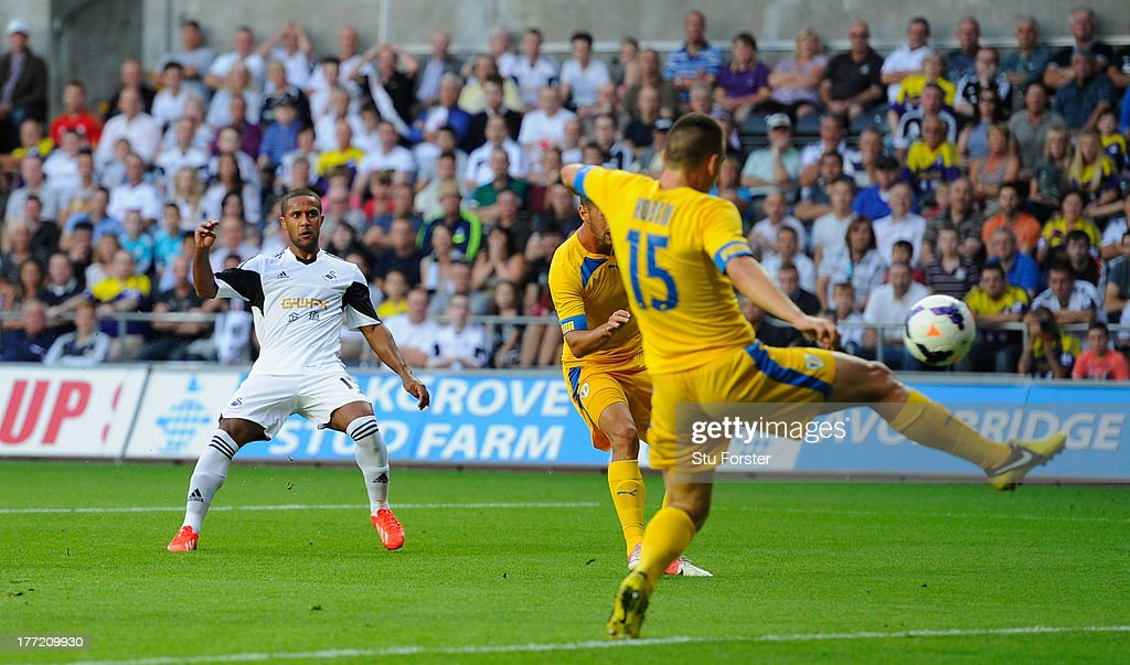 Swansea player <a gi-track='captionPersonalityLinkClicked' href=/galleries/search?phrase=Wayne+Routledge&family=editorial&specificpeople=206672 ng-click='$event.stopPropagation()'>Wayne Routledge</a> scores the opening goal during the UEFA Europa League play-off first leg between Swansea City and FC Petrolul Ploiesti at Liberty Stadium on August 22, 2013 in Swansea, Wales.