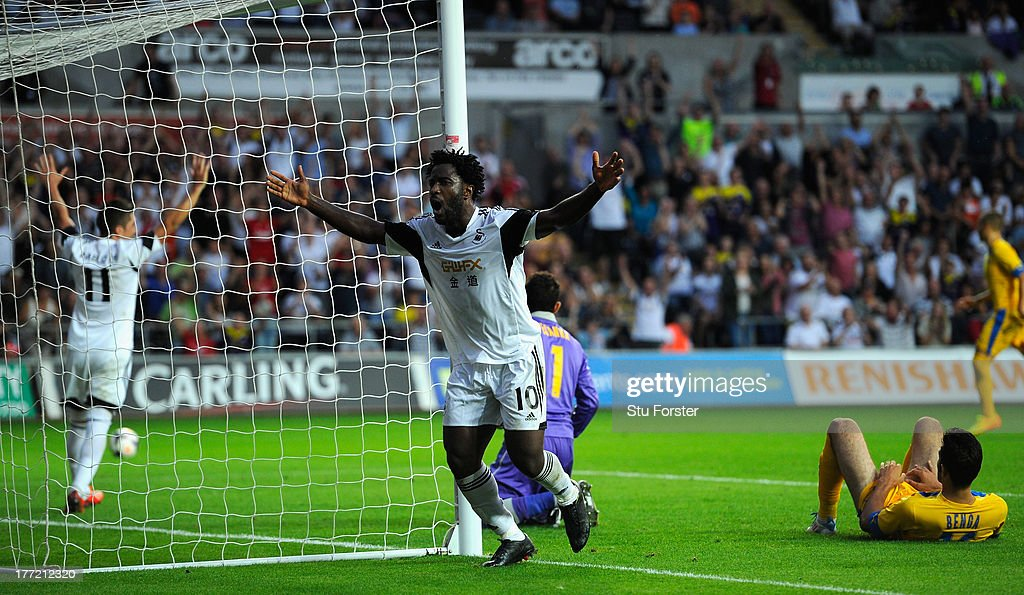 Swansea player <a gi-track='captionPersonalityLinkClicked' href=/galleries/search?phrase=Wilfried+Bony&family=editorial&specificpeople=4231248 ng-click='$event.stopPropagation()'>Wilfried Bony</a> celebrates after scoring the fourth swansea goal during the UEFA Europa League play-off first leg between Swansea City and FC Petrolul Ploiesti at Liberty Stadium on August 22, 2013 in Swansea, Wales.
