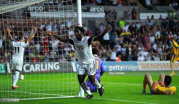 Swansea player Wilfried Bony celebrates after scoring the fourth swansea goal during the UEFA Europa League playoff first leg between Swansea City...