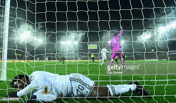 Swansea player Wilfried Bony ends up in the back of the net after a near miss during the Barclays Premier League match between Swansea City and...