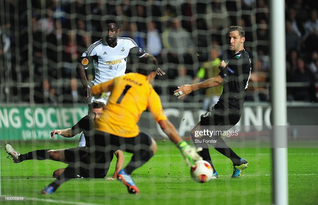 Swansea player <a gi-track='captionPersonalityLinkClicked' href=/galleries/search?phrase=Wilfried+Bony&family=editorial&specificpeople=4231248 ng-click='$event.stopPropagation()'>Wilfried Bony</a> gets in a shot at goal which is turned in by Wayne Routledge (not pictured) for the first Swansea goal during the UEFA Europa League match between Swansea City and FC St Gallen at Liberty Stadium on October 3, 2013 in Swansea, Wales.