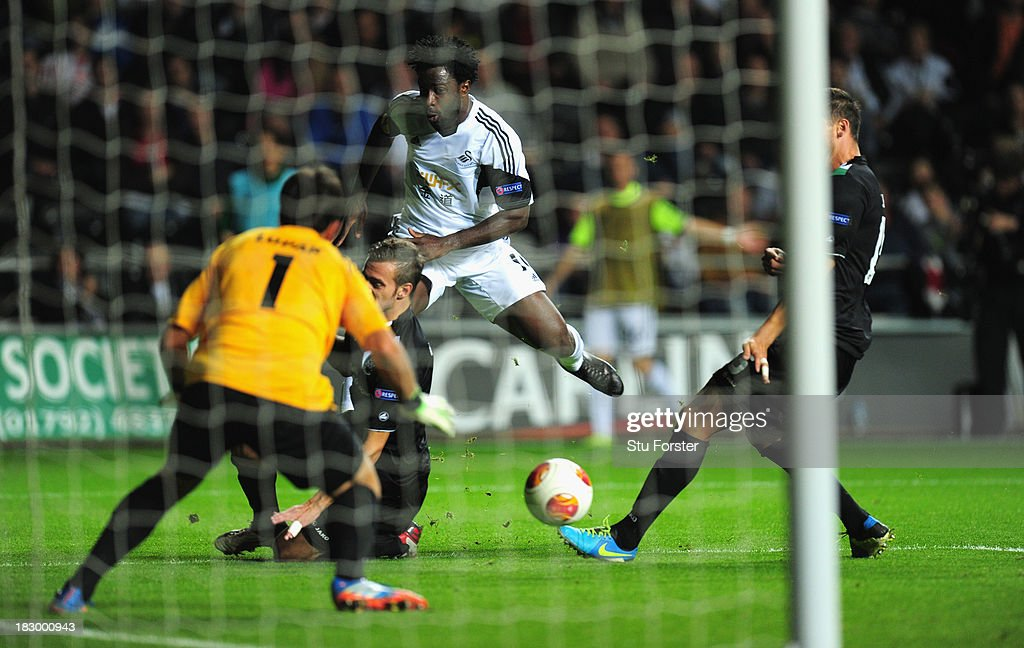 Swansea player <a gi-track='captionPersonalityLinkClicked' href=/galleries/search?phrase=Wilfried+Bony&family=editorial&specificpeople=4231248 ng-click='$event.stopPropagation()'>Wilfried Bony</a> gets in a shot at goal which is turned in by Wayne Routledge ( not pictured) for the first Swansea goal during the UEFA Europa League match between Swansea City and FC St Gallen at Liberty Stadium on October 3, 2013 in Swansea, Wales.