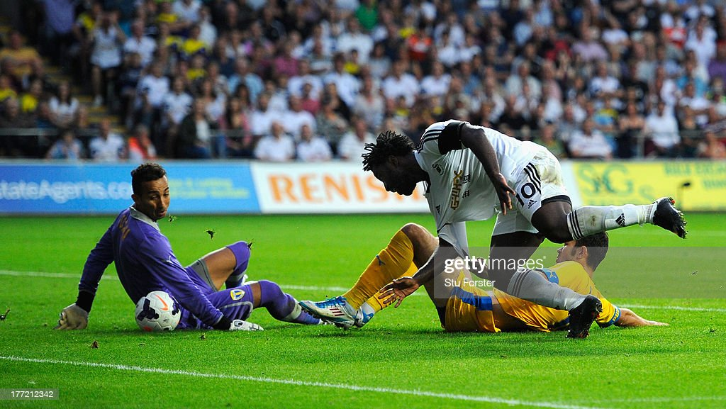 Swansea player <a gi-track='captionPersonalityLinkClicked' href=/galleries/search?phrase=Wilfried+Bony&family=editorial&specificpeople=4231248 ng-click='$event.stopPropagation()'>Wilfried Bony</a> stoops to head in the fourth swansea goal during the UEFA Europa League play-off first leg between Swansea City and FC Petrolul Ploiesti at Liberty Stadium on August 22, 2013 in Swansea, Wales.