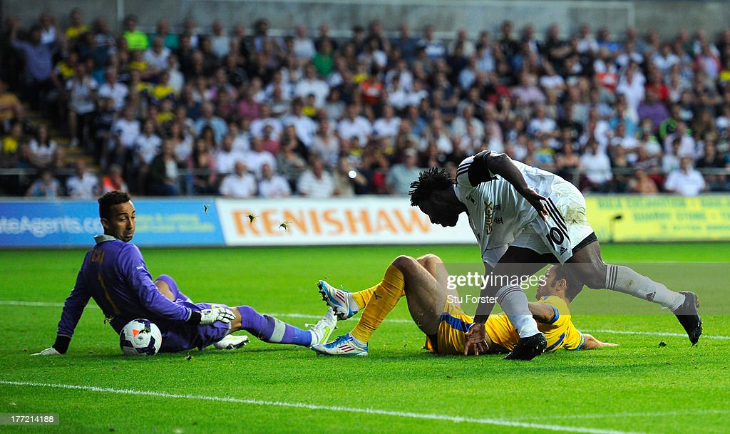 Swansea player Wilfried Bony stoops to head in the fourth swansea goal during the UEFA Europa League play-off first leg between Swansea City and FC Petrolul Ploiesti at Liberty Stadium on August 22, 2013 in Swansea, Wales.