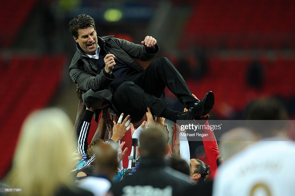 Swansea players lift up Manager of Swansea City <a gi-track='captionPersonalityLinkClicked' href=/galleries/search?phrase=Michael+Laudrup&family=editorial&specificpeople=2380115 ng-click='$event.stopPropagation()'>Michael Laudrup</a> after their 5-0 victory in the Capital One Cup Final match between Bradford City and Swansea City at Wembley Stadium on February 24, 2013 in London, England.