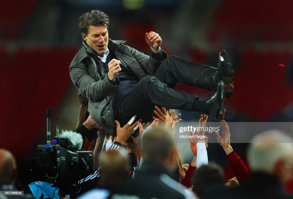 Swansea players lift up Manager of Swansea City <a gi-track='captionPersonalityLinkClicked' href=/galleries/search?phrase=Michael+Laudrup&family=editorial&specificpeople=2380115 ng-click='$event.stopPropagation()'>Michael Laudrup</a> after their 5-0 victory in the the Capital One Cup Final match between Bradford City and Swansea City at Wembley Stadium on February 24, 2013 in London, England.