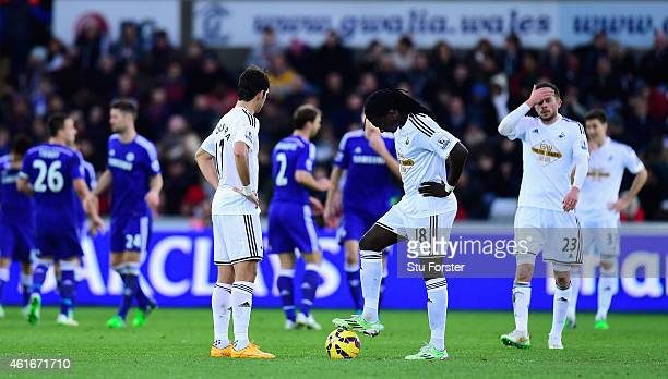 Swansea players react as they prepare to kick off after going 30 down during the Barclays Premier League match between Swansea City and Chelsea at...
