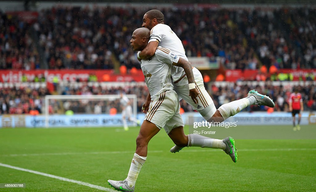 Swansea striker Andre Ayew (left) celebrates with Ashley Williams after scoring the first swansea goal during the Barclays Premier League match between Swansea City and Manchester United on August 30, 2015 in Swansea, United Kingdom.