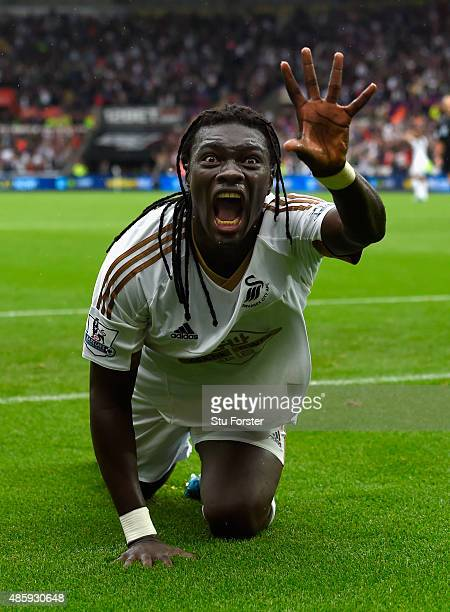 Swansea striker Bafetimbi Gomis celebrates after scoring the second swansea goal during the Barclays Premier League match between Swansea City and...