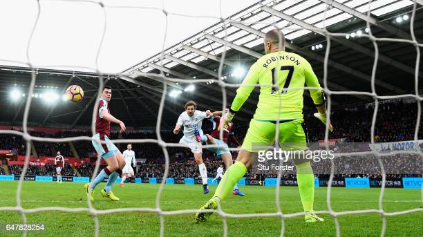 Swansea striker Fernando Llorente scores the opening goal past Burnley goalkeeper Paul Robinson during the Premier League match between Swansea City...