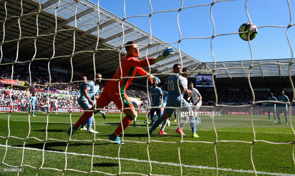 Swansea striker Fernando Llorente (centre right) watches his header go past Stoke goalkeeper Jack Butland for the first goal during the Premier League match between Swansea City and Stoke City at Liberty Stadium on April 22, 2017 in Swansea, Wales.