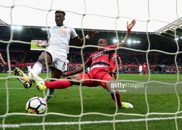 Swansea striker Tammy Abraham scores his second goal despite the challenge of Zanka during the Premier League match between Swansea City and...