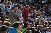 Swansea supporters react to Swansea City's Spanish defender Chico Flores being sent off for a tackle on Chelsea's German striker Andre Schurrle...