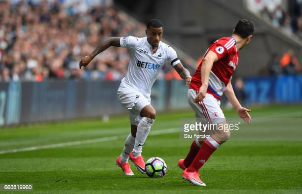 Swansea winger Luciano Narsingh takes on Stewart Downing of the Boro during the Premier League match between Swansea City and Middlesbrough at...