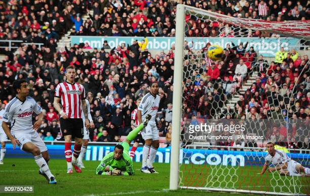 Swansea's goal keeper Michel Vorm dives in vain as Sunderland's Stephane Sessegnon scores during the Barclays Premier League match at the Stadium of...