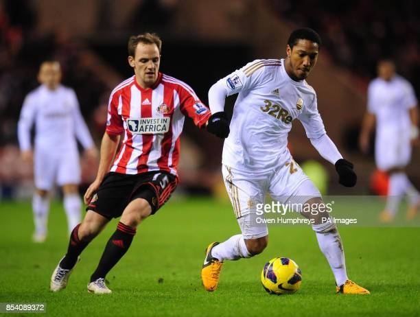Swansea's Jonathan De Guzman and Sunderland's David Vaughan in action during the Barclays Premier League match at the Stadium of Light Sunderland
