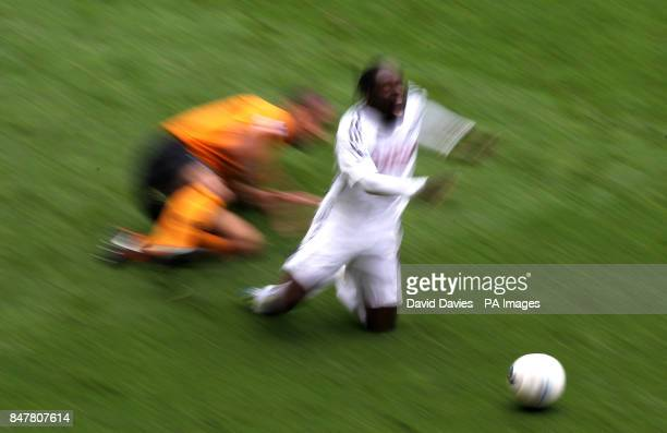 Swansea's Nathan Dyer is fouled by Wolves' Karl Henry during the Barclays Premier League match at the Liberty Stadium Swansea